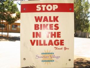 Walk Bikes In Village Sign
